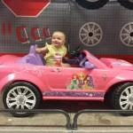 Arianna in pink sports car